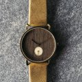 Gold toned ladies watch with walnut dial  Kerbholz